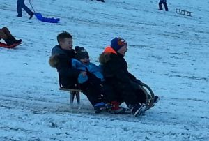 3 of my little cousins racing down the slope