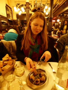 Sarah, trying some of the escargots at Bouillon Chartier