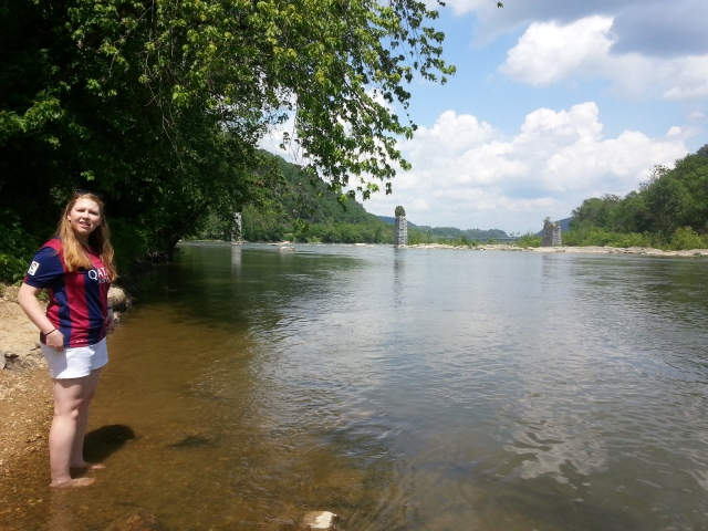 After walking back and forth across the bridge, we went down to the actual water. We sought some shelter from the heat and stuck our tired feet in the lukewarm water of the Shenandoah river