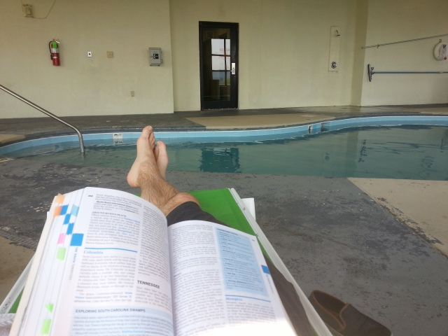 Doing some research next to the pool