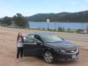 Sarah with our rental car, in Nederland (Colorado)