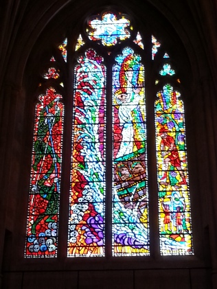 One of the beautiful windows, all depicting biblical stories.