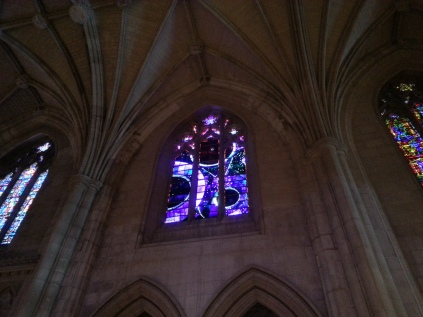 The stained-glass window about the moon landing, with an actual moon rock in it!